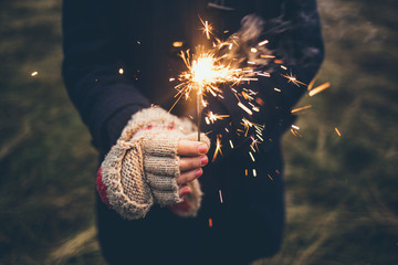 Woman With Gloves Holding a Sparkler