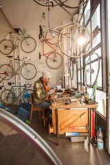 Man Working in a Bicycle Repair Shop