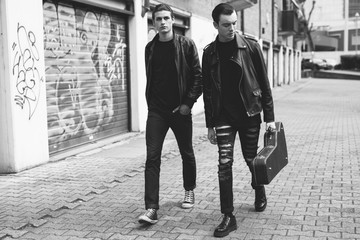 Young punk rockers walking in the street