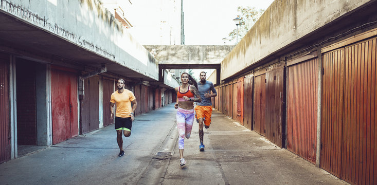 Group of Athletes Running Together