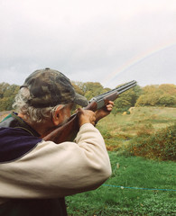 Man with a rifle shooting