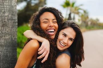 Happy multiethnic female friends outdoors in summer