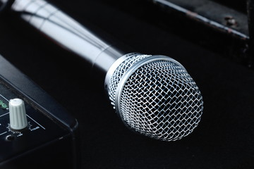 New silver microphone isolated on black background