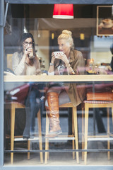 Smiling Women Drinking Coffee at a Coffee Shop