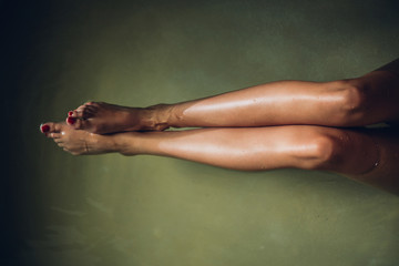 Woman's Legs in a Bathtub filled with Water