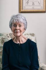 Senior Pretty Mature Woman Sitting In Chair