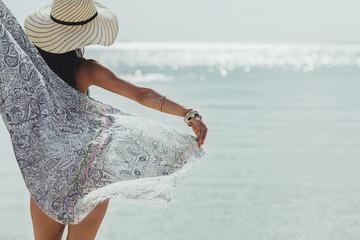 Beautiful Woman in a Bikini Standing by the Sea