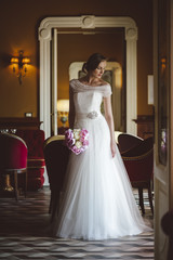Fashion young bride in a luxury location