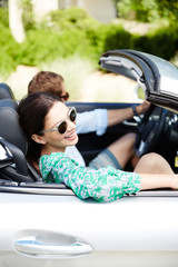 Beautiful couple going on road trip in convertible car