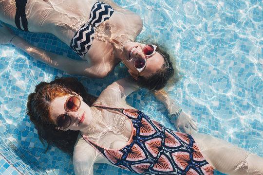 Girls Lying in the Swimming Pool