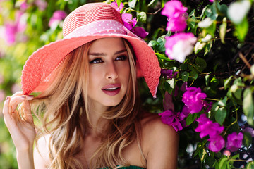 Beautiful Blond Woman in Flower Garden
