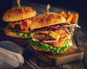 Delicious homemade hamburger on wooden background