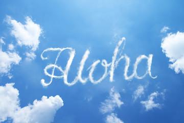 Aloha hand cloud written word on sky background. Calligraphy style.