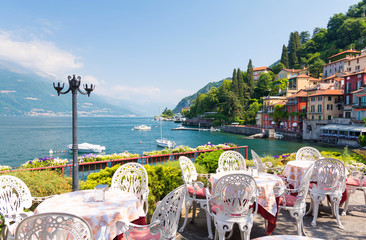 restaurant terrace with view of beautiful Varenna old town, Lake Como, Italy