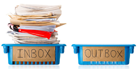 Procrastination - A full Inbox tray and an empty Outbox tray - Overwhelmed - Isolated on white background