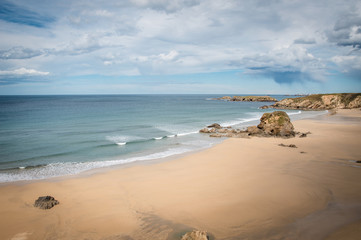 Idyllic beach in La isla, Asturias on a day in spring in Spain