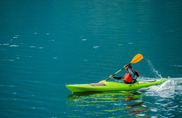 Caucasian Kayaker on the Lake