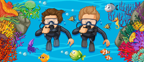 Scuba divers in the deep blue sea