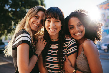 Beautiful female friends looking happy together