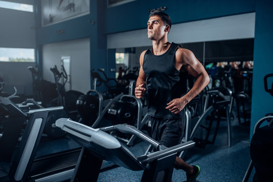 Male athlete workout on running exercise machine