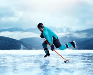 Professional hockey player exercise on frozen lake