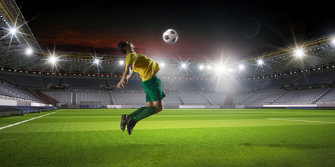 Soccer player at sport arena