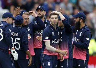 England's Mark Wood celebrates the wicket of Australia's Glenn Maxwell