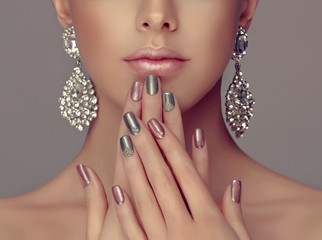 Printed kitchen splashbacks Manicure Beautiful model girl with pink and gray silver metallic manicure on nails . Fashion makeup and cosmetics . Big silver diamond shine earrings jewelry .