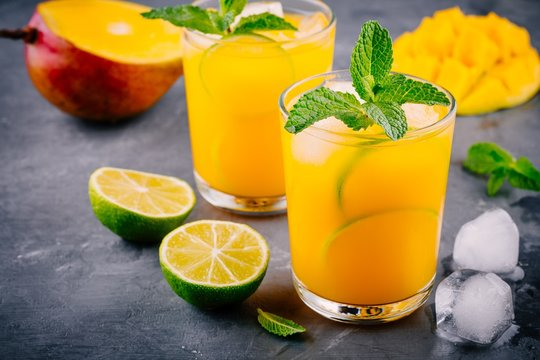 Fresh summer mango lemonade with lime and mint