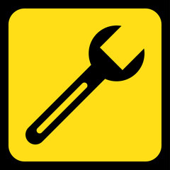 yellow, black information sign - spanner icon