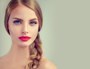Beautiful young woman with braid hair  and red lips . Fashion ,beauty and cosmetics