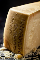 Slice of parmesan cheese showing name