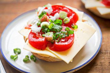 Fresh roll with cheese, tomato and sliced spring onion