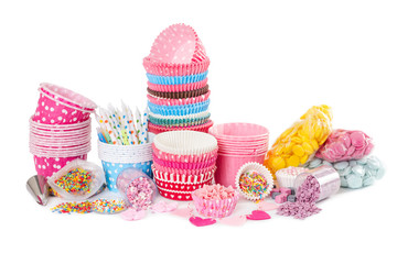 Paper cups for cupcake and colorful sprinkling for decorating