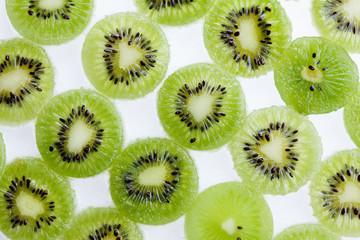 Green kiwi fruit slice. Juicy freshness food background