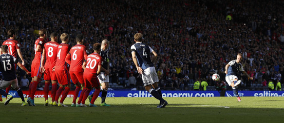 Scotland's Leigh Griffiths scores their second goal from a free kick