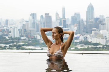 Woman relaxing on a rooftop pool