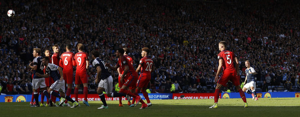 Scotland's Leigh Griffiths scores their first goal from a free kick