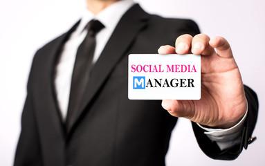 Businessman Showing His Social Media Manager Visiting Card