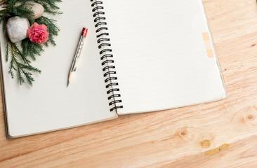 notebook  on wooden floor.