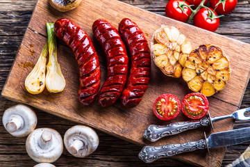 Sausages. Grill sausages. Grilled sausage with mushrooms garlic tomatoes and onions.