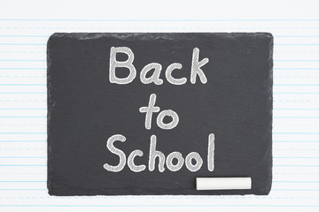 Back to School message on a weathered old chalkboard
