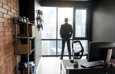Stylish male managing director is enjoying city landscape