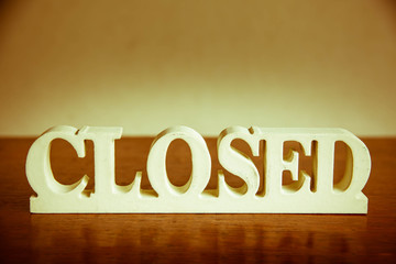 Closed sign wood on table