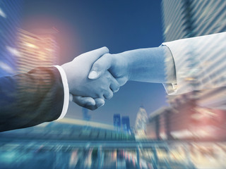 Business handshake. Two business people shaking hands in the office.Successful business people handshaking closing a deal.Business People Shaking Hands Agreement Concept.Lighting color effect.