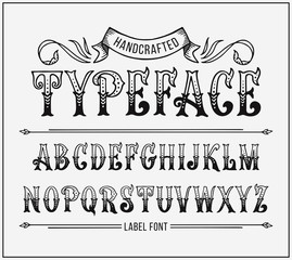 Handcrafted letters with Victorian decor. Vector label font