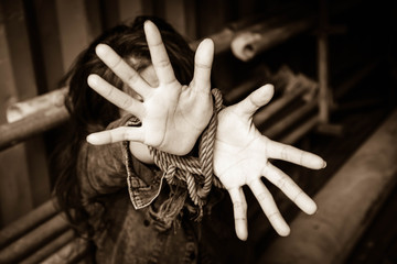 Blurry portrait of woman hands tied up with rope ,Missing kidnapped