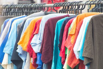 Row of hanged colorful T-shirt.