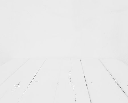 Empty white table on white blurred background wall