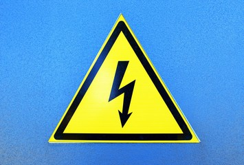 High voltage sign on blue metal plate